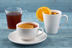 Tea in various dishes stock photo