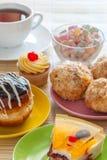 Tea and various tasty sweet dessert Stock Photos