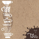 Tea. Vector illustration of teacups, decorative elements and pla. Tea. Vector background with hand-drawn on kraft paper. Illustration with place for text Stock Images