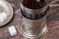 Tea in vintage glass with glass-holder Stock Photos