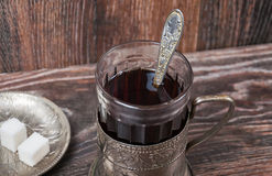 Tea in vintage glass with glass-holder Royalty Free Stock Photography