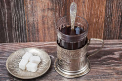 Tea in vintage glass with glass-holder Royalty Free Stock Photos