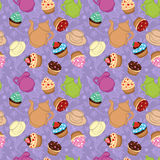 Tea violet background  with cupcakes Royalty Free Stock Image