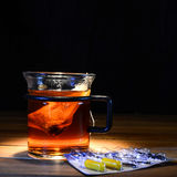 Tea with vitamin pills. On a table Royalty Free Stock Photo