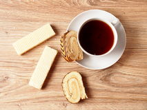 Tea. With a wafer and a roll with chocolate strips Royalty Free Stock Image