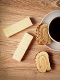 Tea. With a wafer and a roll with chocolate strips Stock Image