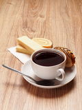 Tea. With a wafer and a roll with chocolate strips Royalty Free Stock Images