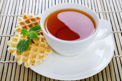 Tea with waffle and mint on Bamboo place mat Royalty Free Stock Image