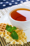 Tea with waffle and mint on Bamboo place mat Stock Photography