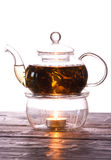 Tea-white. Profile of a glass teapot full of chinese tea with a white background Royalty Free Stock Photo