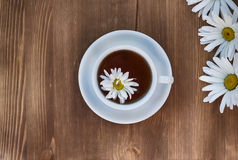 Tea in a white cup. Of herbal tea of chamomile royalty free stock image