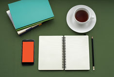 Tea in white cup with Journal book and smartphone Stock Photography