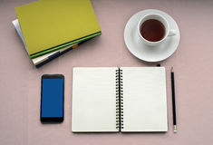 Tea in white cup with Journal book and smartphone Stock Photos