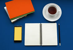 Tea in white cup with Journal book and smartphone Royalty Free Stock Photo