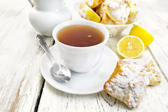Tea in white cup with lemon cookies on board Royalty Free Stock Photography