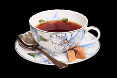 Tea in a white cup. Saucer with sugar and a spoon Royalty Free Stock Photography