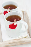 Tea in white cups Stock Photo