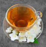 Tea with white flowers of jasmine Royalty Free Stock Photo