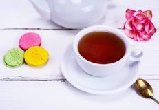 Tea in a white round cup with a saucer Royalty Free Stock Images