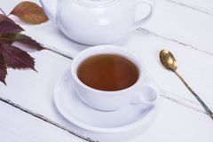 Tea in a white round cup and saucer Royalty Free Stock Images