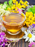 Tea from wild flowers in glass cup on board Stock Photo