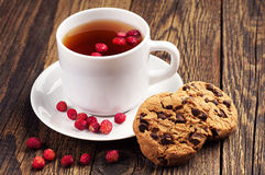 Tea with wild strawberries and cookies Stock Images