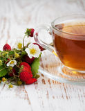 Tea and wild strawberries Royalty Free Stock Images