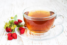 Tea and wild strawberries Royalty Free Stock Photos
