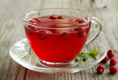 Tea with wild strawberry Royalty Free Stock Images