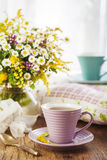 Tea and wildflowers Stock Photography