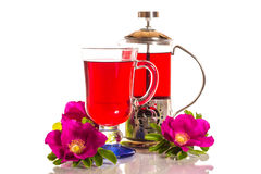 Tea With Rose Hips With Flowers Stock Image