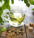 Tea on wooden boards with green leaves Stock Images