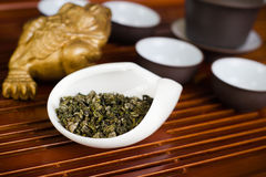Tea leaves dry in cup on wooden table. Chinese tea in white cup Stock Photo