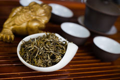 Tea on wooden table. Chinese tea in white cup Royalty Free Stock Photo