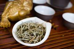Tea on wooden table. Chinese tea in white cup Royalty Free Stock Photography