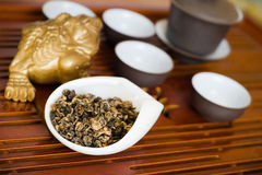 Tea on wooden table. Chinese tea in white cup Royalty Free Stock Photos