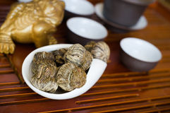 Tea on wooden table. Chinese tea in white cup Stock Photo