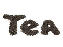 Tea word, made from tea leaves. Tea word, made from black tea leaves Royalty Free Stock Photo
