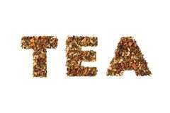Tea - word written by dried herbs and fruits stock photo