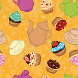 Tea yellow background  with cupcakes Stock Image