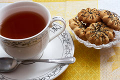 Tea on yellow background. Tea, porcelain cup, yellow background, cookies Royalty Free Stock Photo