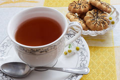 Tea on yellow background. Tea, porcelain cup, yellow background, cookies Stock Images