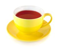 Tea in the yellow cup Stock Photos