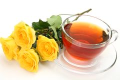Tea and yellow roses Stock Image