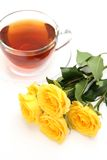 Tea and yellow roses Stock Photo