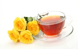 Tea and yellow roses Royalty Free Stock Photography