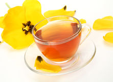 Tea and yellow tulip Royalty Free Stock Photography