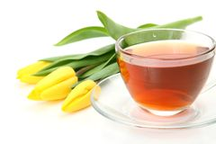 Tea and yellow tulips Royalty Free Stock Images