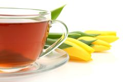 Tea and yellow tulips Royalty Free Stock Photo