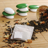 Teabag on Green Tea Stock Image